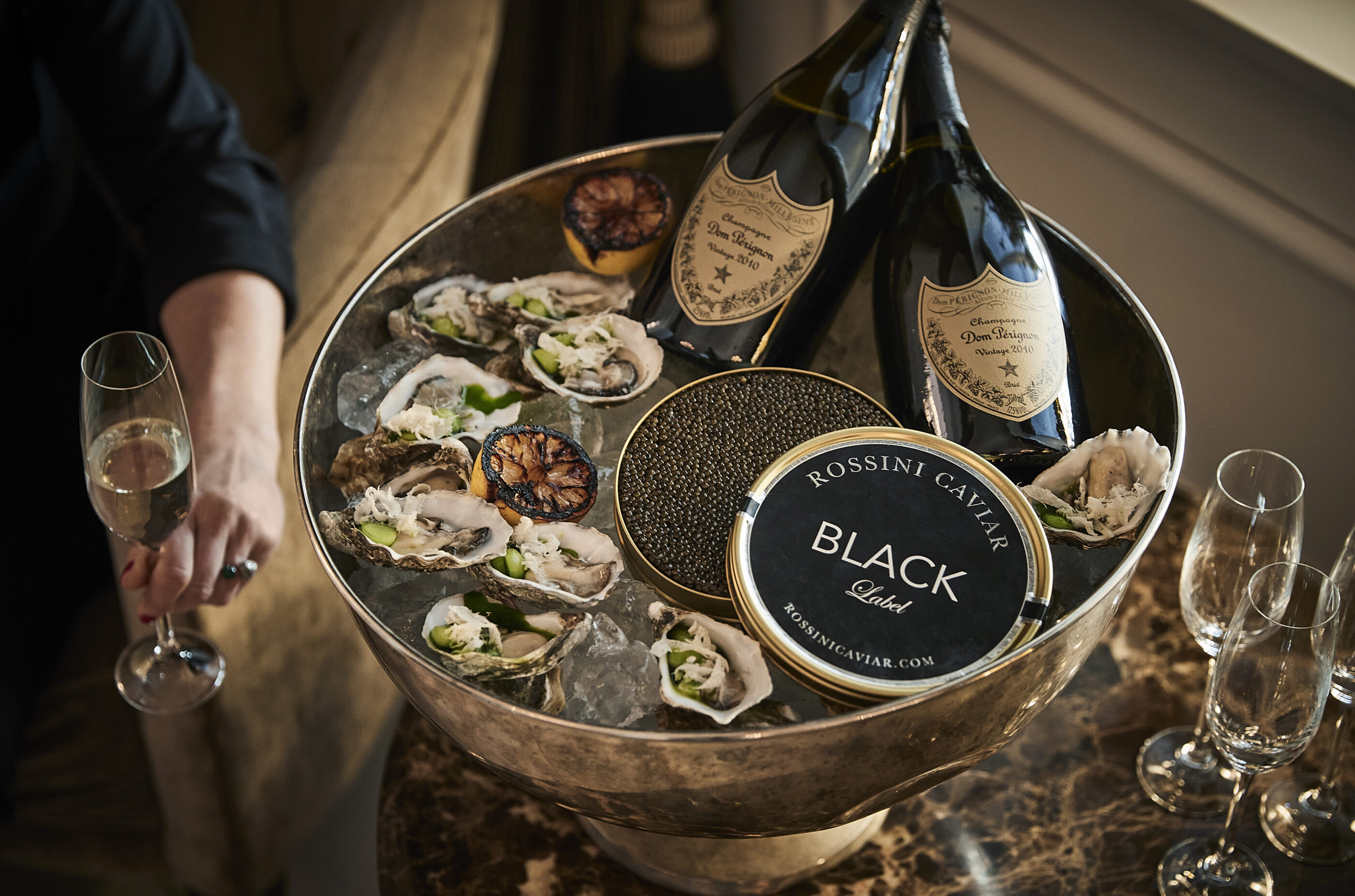 Delicious bowl of caviar, oysters and champagne