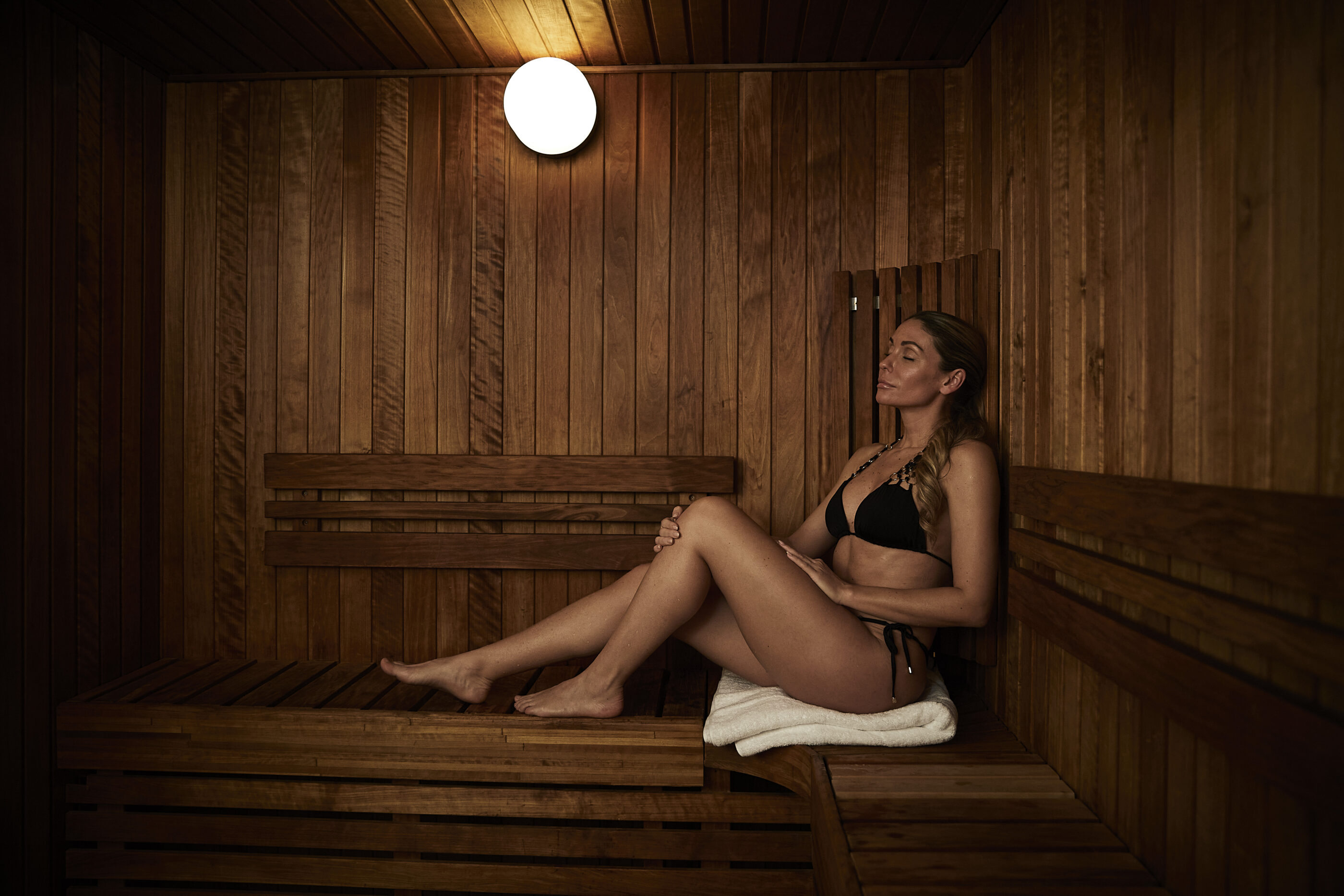 A woman relaxing in the finnish sauna